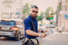 Bearded man travels with map Royalty Free Stock Photos