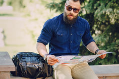 Bearded man travels with map Royalty Free Stock Photography