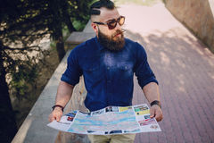 Bearded man travels with map Stock Photo