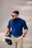 Bearded man travels with map Royalty Free Stock Photo
