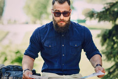 Bearded man travels with map Stock Image
