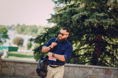 Bearded man travels with map Royalty Free Stock Image