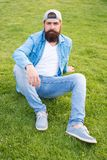 Bearded man trendy hipster style. Guy modern outfit. Casual and comfortable. Hipster lifestyle. Cool hipster with beard. Wear stylish baseball cap. Brutal stock photo