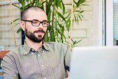 Bearded man using laptop Royalty Free Stock Photo