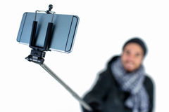 Bearded man using a selfie stick Royalty Free Stock Image