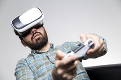 Bearded man in vr glasses with controller close up Royalty Free Stock Photo