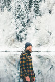 Bearded Man walking alone lake and forest winter landscape Royalty Free Stock Photos