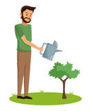 Bearded man watering plant Stock Photography