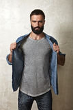 Bearded man wearing blank grey t-shirt Stock Photos