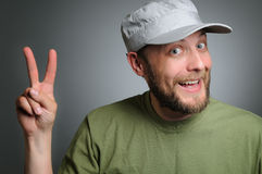 A bearded man wearing a cap to victory Stock Photo