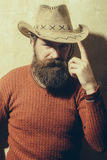 Bearded man wearing cowboy hat Stock Photography