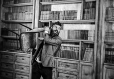 Bearded man wearing formal outfit. Looking crazy. Over library background royalty free stock images