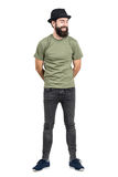 Bearded man wearing hat and t-shirt laughing carefree with eyes closed Royalty Free Stock Image