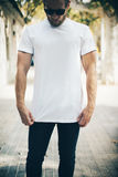 Bearded man wearing white blank t-shirt and blue Royalty Free Stock Photo