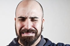 Bearded man who cries Stock Photos