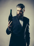 Bearded man with wine bottle Stock Photo