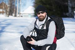 Bearded man in winter travels. Stock Photos