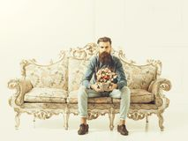 Free Bearded Man With Flowers On Sofa Stock Photos - 152662073