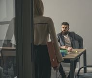 Bearded man and woman have business meeting. Boss talk to secretary in office. Businessman and businesswoman at work. Bearded men and women have business meeting Royalty Free Stock Photography