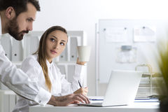 Bearded man and a woman in an office Stock Photos