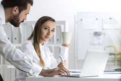 Bearded man and a woman at work, side view Stock Photography