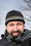 Bearded man with a wool cap and scarf Stock Photography