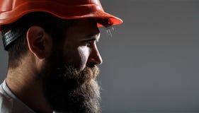Bearded man worker with beard in building helmet or hard hat. Man builders, industry. Portrait architect builder, civil. Engineer working. Builder in hard hat royalty free stock photos