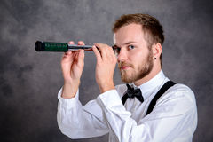 Bearded manlooking looking through a telescope Stock Image