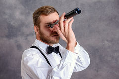 Bearded manlooking looking through a telescope Stock Photos