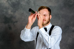 Bearded manlooking looking through a telescope Stock Photo