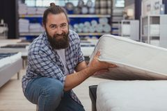 Bearded mature man shopping at furniture store royalty free stock photos