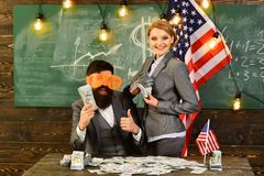 Bearded man and woman with dollar money plan travel. Economy and finance. Independence day of usa. American education stock images