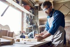 Hammering Nails into Board Royalty Free Stock Photo