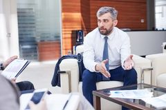 Discussing Cooperation with Business Partner Stock Photos