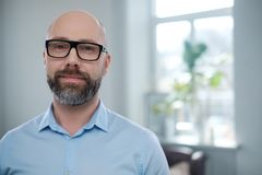 Bearded middle-aged man wearing glasses. stock photography