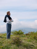 Bearded, middle aged man in wilderness landscape Royalty Free Stock Images