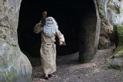 The bearded monk carries log. Royalty Free Stock Photo