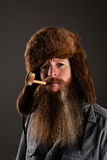 Bearded mountain man smoking a pipe Royalty Free Stock Photography