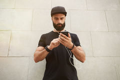 Bearded Muscular Man Wearing Black Tshirt Blank Snapback Cap Summer Time.Young Men Standing Opposite Empty Gray Concrete Royalty Free Stock Photo