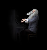 Bearded musician plays the piano Royalty Free Stock Photos