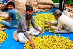 Bearded muslim fruits trader work on the street ma Stock Photos