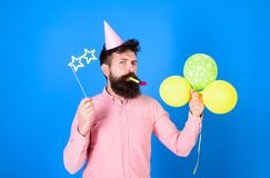 Bearded party entertainer at kids celebration, International children day concept. Man with bright balloons, paper. Glasses and cap at birthday party. Bearded stock photos