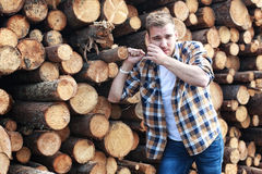 Bearded person near timber pile wood Stock Photo