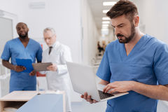 Bearded physician using modern technologies in the clinic Stock Photo