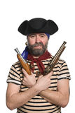 Bearded pirate in tricorn hat with a muskets Royalty Free Stock Image
