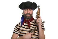 Bearded pirate in tricorn hat with a muskets. Royalty Free Stock Images