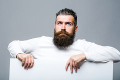 Bearded sad man with paper Stock Image