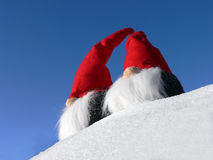Bearded Santas on Snow. Two bearded santas on a snowy slope under a bright blue sky Royalty Free Stock Photography