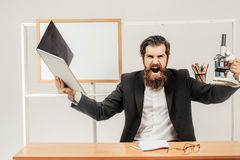 Bearded scientist shouts Stock Photos