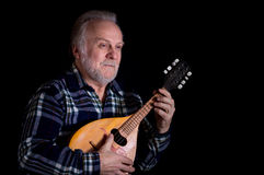 Bearded senior man with mandolin Stock Photos